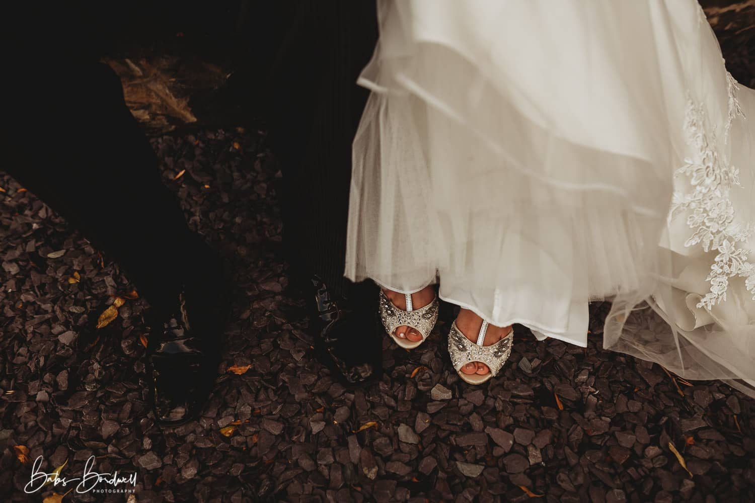 close-up of bride and groom's shoes